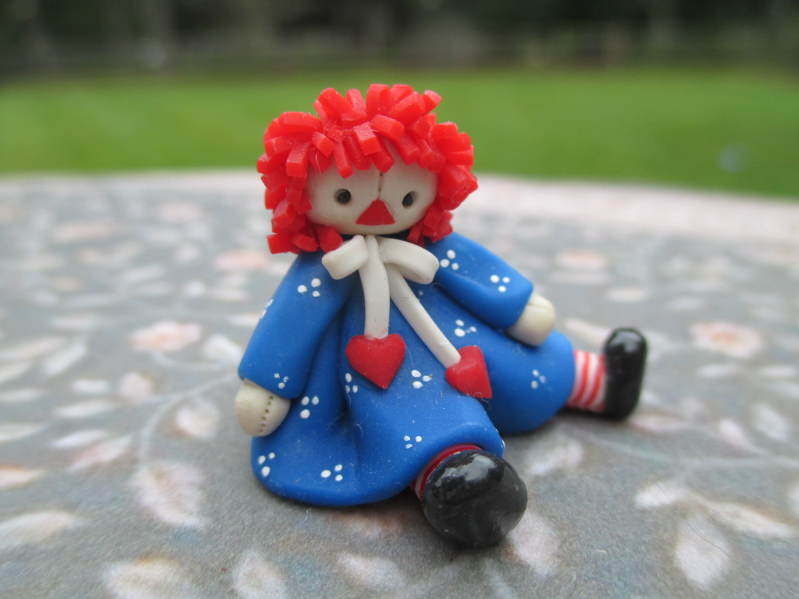 Handmade Raggedy Ann From Clay/Fimo Sitting & Wearing Dress