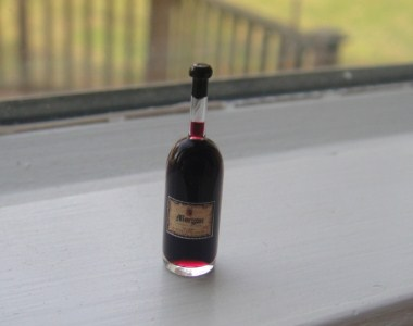 Glass Bottle with Red Wine Liquid
